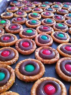 Christmas Prezels    Ingredients:  Small Pretzels  Hershey's Kisses (unwrapped)  m&ms  Directions:  Top each pretzel with a Hershey's Kiss, and place in a preheated 200ºF oven for 10 minutes. Remove and immediately press an m&m into the top of each kiss. Let cool completely!