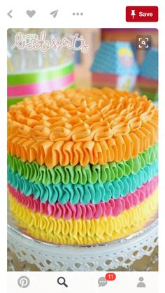 Colorful ruffle round cake in buttercream.
