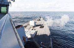 The Arleigh Burke-class destroyer USS Ross (DDG 71) fires its 5-inch gun during a live-fire evolution.