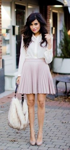 Pleated mini skirt + trend spring + Sazan Bargain + faux fur bag + white blouse  Shirt: Luna B, Faux Fur: H&M, Shoes: Christian Louboutin.