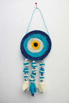 This unique wool felt evil eye wall hanging is handmade. Evil eye is very special gift wall hanging for friends. Handmade needle felting hanging is so cute for yor home decor or your friends. Felt evil eye is a protect for your home and you. Hanging Ornaments, Felt Ornaments, Evil Eye Art, Like Symbol, Talisman, Thinking Day, Handmade Felt, Wall Hanger, Felt Crafts