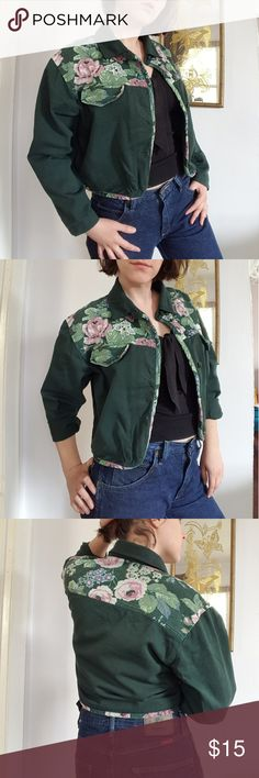 "Vintage Green and Floral cropped jean jacket Vintage forest green and floral cropped jean jacket. By New. 100% cotton, made in USA. Marked a size Medium- 21"" armpit to armpit, 19"" long. The buttons are hand sewn on and are a bit loose but can be easily repaired. Overall in good condition with some stray threads and small flaws throughout. #floral #vintage #autumn #fall #jeanjacket #cropped Vintage Jackets & Coats Jean Jackets"