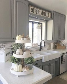Kitchen Makeover White 3 Tiered Stand with Cute Farmhouse Items - 30 Farmhouse Tabletop Arrangement Centerpiece ideas and inspiration for your next farmhouse style makeover. Farmhouse Tabletop, Farmhouse Kitchen Decor, Kitchen Redo, Kitchen Dining, Dining Area, Rustic Farmhouse, Gray Kitchen Cabinets, Kitchen Backsplash, Decorating Kitchen