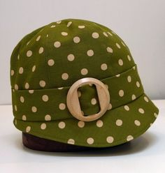 Olive polka-dot linen cloche hat with wooden buckle, made to order by bonniesknitting on Etsy.