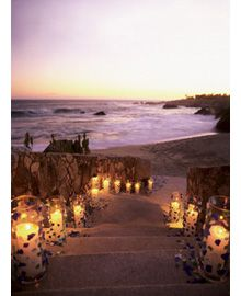 If your ceremony is at sunset, add a pathway of candles leading to the beach. It's inexpensive and romantic! #lighting #wedding