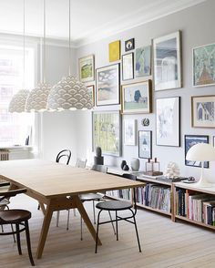 """15 Gallery Walls So Glorious, You'll Want To Copy Them, Stat #refinery29  http://www.refinery29.com/photo-wall-guide#slide-14  A commanding wall offers ample opportunity to make a salon-style statement. Anchor a large space by hanging a bigger picture left of the wall's center, and then adding in <a href=""""http://www.urbanoutfitters.com/urban/catalog/productdetail.jsp?id=18543884&category=SEARCH+R..."""