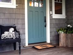 Teal Blue Front Door and gray siding