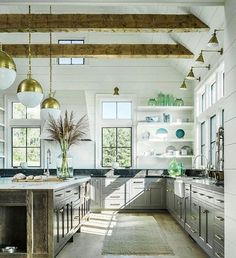 5 Tips To Decorating Your Home Like A Pro! Farmhouse kitchen with vaulted ceiling, exposed beams, shiplap walls, shiplap ceiling, black metal Farmhouse Kitchen Island, Modern Farmhouse Kitchens, Home Kitchens, Rustic Farmhouse, Kitchen Grey, Farmhouse Design, Kitchen Modern, Open Kitchen, Farmhouse Cabinets