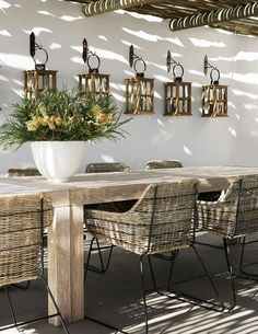 contemporary rattan chairs and rustic wooden table for outdoor dining