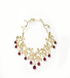 N101    18 Kt Gold, Ruby & White Sapphire Necklace  Total Ruby Wt: 69.8 ct  Total Sapphire Wt: 26.5 ct    Length: 18 in    $36,000    http://www.arianezurcher.com/node/104#panel-7