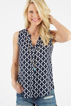Sleeveless blouse, like the print, color, and fabric. cut maybe would be better if it was little longer