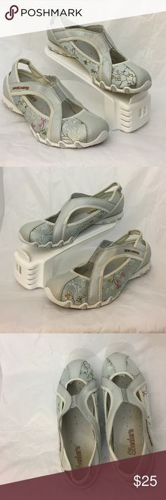 Skechers Biker bloom shoes These are a lightly worn pair of Sketchers Active Wear Bikers Bloom slip on shoes.  Material is Light blue silver-ish with white, green and pink flowers sewn into it.  Straps are silver-ish color and the soles are gray and white.   Size US 9.5 Leather textile upper Made in China SN 21453 Skechers Shoes Athletic Shoes