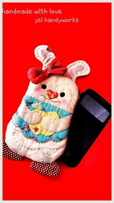 Bunny style handphone case. https://www.etsy.com/listing/191498933/applique-handmade-phone-pouch
