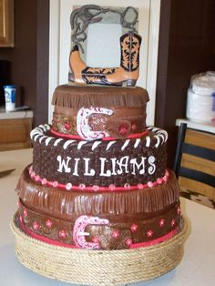 This is the first time I have ever worked Chocolate fondant or covered a cake in it at all. This was for my daughter?s western wedding