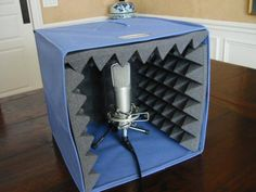 Desktop mic booth: Porta-Booth. Via http://voiceactingalliance.com/board/showthread.php?58643-How-to-Improve-your-Mic-Quality-Without-Buying-a-New-One!
