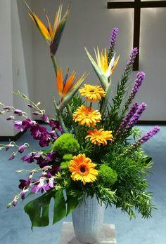 Birds, orchids,gerbera and liatris for a sympathy design