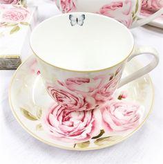 Te-kopp med fat m. rosmotiv