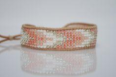 Beaded loom bracelet, toho beads, white leather cord by ZUZILICIOUS on Etsy https://www.etsy.com/listing/238171096/beaded-loom-bracelet-toho-beads-white