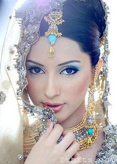 indian bridal makeup. blue and gold.
