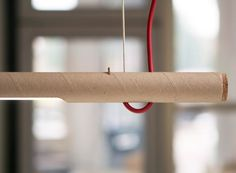 By using an LED bulb, the studio made sure the light won't overheat and damage the cardboard fixture