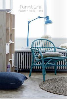 turquoise rattan chair..