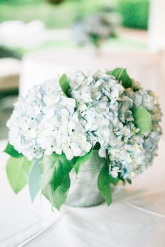 charming blue hydrangea arrangement in a champagne bucket by Flowers on Chestnut
