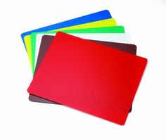 """Tablecraft 18 X 24"""" Assorted Colors Flexible Cutting Mats by Tablecraft Products. $27.31. Made of Polyethylene Plastic. NSF Approved. 1.4 MM Thick. Includes: (1) Blue, (1) Yellow, (1) Green, (1) White, (1) Brown, and (1) Red Cutting Mat. Dimensions: 18"""" x 24"""". The Tablecraft FCB1824A 18"""" x 24"""" flexible cutting board set is great for any restaurant or catering occasion. These dishwasher-safe cutting boards are constructed of polyethylene making them flexible and lightweight. Th..."""