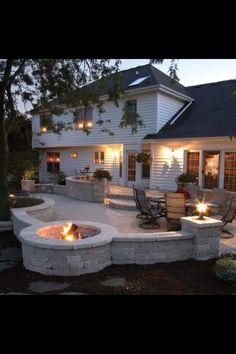 We could extend our patio and do something like this with the fire pit....