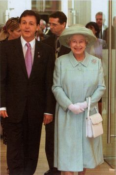 The Queen with Paul McCartney in Liverpool, 2002.   I'd be beaming too if I were standing next to Paul.