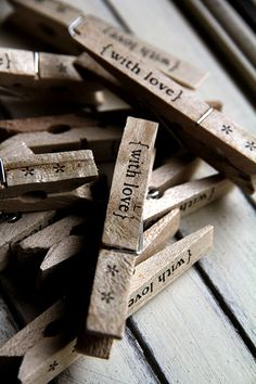 wooden pegs ♥ These would be adorable to close a Valentine treat bag.  - Or for shabby chic wedding favors? - new use for all of weathered clothes pins that sat outside too long.