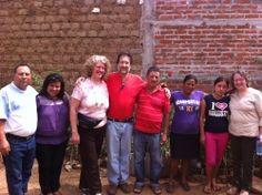 Visiting and praying in homes, La Magdalena, El Salvador.  Mission trip 2013