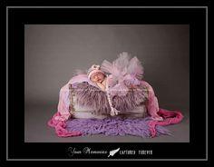 Newborn girl, somewhere in that tutu!