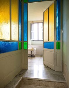 The colored panes in the bathroom of the third guest suite were original to the property.