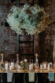 ###Reception Decor    When we said baby's breath could be beautiful en masse we meant it! This gorgeous installation, from an event thrown by [Jove Meyer](http://www.jovemeyerevents.com/), looks like an ethereal cloud floating lazily over the table.