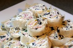 Tortilla Roll-ups   Cream cheese, green chiles, black olives, chives, and ham. YUMMMM!