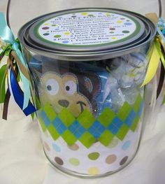 custom made baby gift pail with a personalized lid. -- Might use this idea for my cousin's 21st birthday (but more grown up, of course!)