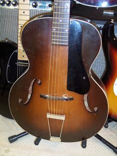 Sonata guitar from the 1930's. Probably made by Harmony Guitar company. Solid top, back and sides. Very cool.
