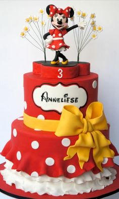 I dont like the look of Minnie mouse on the top, but I love the bottom tier and the yellow ribbon. Would make with Minnie Mouse ears cake on top instead - Minnie Mouse Birthday Cake Pictures Minni Mouse Cake, Bolo Da Minnie Mouse, Mickey And Minnie Cake, Bolo Mickey, Minnie Mouse Birthday Cakes, Mickey Cakes, Mickey Birthday, 2nd Birthday, Birthday Ideas