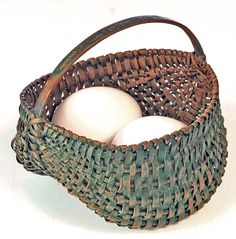 Early Two-Egg Buttocks Basket Good miniature splint baskets are uncommon. Good painted splint baskets are scarce. But good, painted, miniature, splint baskets are genuinely rare—especially in a fully developed buttocks form. Probably made between 1880 and 1920, this is one of the best miniature baskets. 1500.00