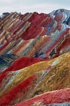 Colored Mountains, China. During the 4.54 billion years, (approximately),  since earth was created a miracle took place in the area known as Danxia Zhangye China. Here the rock layers of colors imaginable in one place, specifically in this area achieve what is perhaps the greatest gathering of different pigments in natural stone in the world.