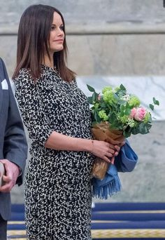 Princess Sofia held a bouquet of flowers as she took to the stage in a loose-fit dress at a music event in Stockholm on 20 January 2016