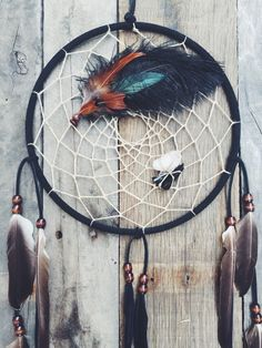 """handmade 10"""" dreamcatcher made with love ~ this creation was inspired by the forest & adventure spirit. the black obsidian & clear Quartz represent yin yang ~ custom orders available at thespiritwoods.etsy.com"""