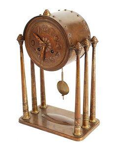 Koperen pendule met ronde wijzerkast ondersteund door zes vrijstaande pilaren ontwerper onbekend uitvoering Winkelman en van der Bijl Amsterdam ca.1925