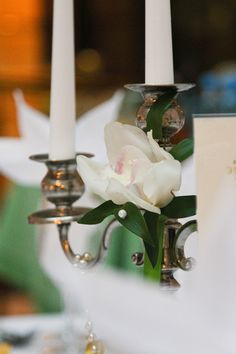 Beautiful flower to decorate candlestick is a gentle touch for wedding