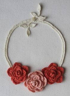 Crocheted Roses Necklace in Peach and Coral by mygiantstrawberry, This is on Etsy and NOT buying a pattern, but it would be easy to make!