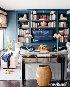 Navy living room with large bookshelf