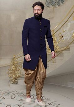 Readymade Khadi Sherwani in Navy Blue This Plain attire is Enhanced with Buttons Available with a Beige Art Silk Dhoti Pant Do note: Footwear shown in the image is for presentation purposes only. Half to one inch may vary in measurement. (Slight variation in actual color vs. image is possible).
