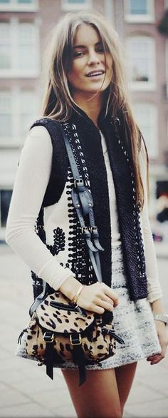 Street style. Fashion-trendy outfit with this animal print bag, mini skirt, vest a nd long sleeve top.