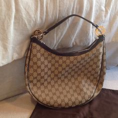 Authentic Gucci Medium Hobo Bag Authentic Gucci medium hobo bag. In perfect condition.  Only used a few times. Comes with dust bag and original Gucci cards.  Has one interior zip pocket and two separate cell phone pockets.  Measurements are 13W, 9H, 4D. Gucci Bags Hobos