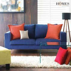 Enliven your space with colour-coordinated upholstered sofa and cushions. Create your own unique style statement. Explore more @ www.homesfurnishings.com #HomeDecor #HomesFurnishings #UpholsteryCollection #Cushions #Furnishings